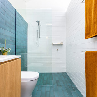 Photo of a small contemporary master bathroom in Canberra - Queanbeyan with furniture-like cabinets, brown cabinets, a one-piece toilet, cement tile, white walls, cement tiles, engineered quartz benchtops, blue floor, a niche, a single vanity, a floating vanity and vaulted.