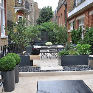 Small contemporary terrace and balcony in London with a pergola.