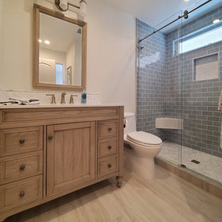 Small french country porcelain tile porcelain tile, beige floor and single-sink bathroom photo in Orange County with beaded inset cabinets, medium tone wood cabinets, a one-piece toilet, an undermount sink, quartz countertops, white countertops and a freestanding vanity