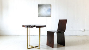 Vignette of Walnut and Brass Table, Patinated Steel Chair and Oil on Wood Painti