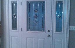 Entry door with White Door Interior & Crown Molding