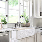 "Nantucket Sinks USA - Nantucket Sinks Double Bowl Farmhouse Fireclay Sink with Filigree Apron - Nantucket Sinks 33-Inch double bowl farmhouse fireclay sink with Filigree apron.  Part of our Vineyard Collection, this sink has an intricate and ornate relief on its apron front.   Set off your decor with its creative design for an unforgettably stylish kitchen!   Enjoy the advantages of a dual function,  double bowl sink with a 50/50 ratio.   There are many benefits to fireclay.  Its glazed surface inhibits bacterial growth more than stainless steel.  It is eco-friendly requiring less cleansers.   Made and hand finished in Italy, each sink is unique.  Due to the firing process, dimensions are nominal and may vary to actual up to .5"".  Custom cabinet or apron cabinet required."