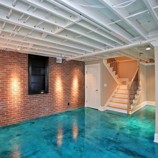 Trendy look-out concrete floor and turquoise floor basement photo in Nashville with gray walls