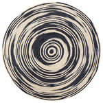 "Anji Mountain - Hurricane Round Rug, 4' - The chic all-natural jute Hurricane Round Rug will sweep you away with its timeless style and whirling, black-and-white pattern. This piece works well in any room and is a great solution for underneath your dining table or as an inviting option for your entryway and living rooms. hand-braided and -stitched by skilled artisans in India, this rug brings a handmade, centuries-old craft tradition into your home with its timeless design. This rug is also eco-friendly and sustainably made from 100% jute. You'll love its gentle feel under your feet and the way its durable, hard-wearing properties protect the floors of your busiest rooms. Note: It is normal for natural fiber rugs to ""sprout"" — what may seem to be a pulled thread is really just a yarn whose fibers have sprouted. This is not a defect but an inherent quality of certain natural fiber rugs. Simply clip the sprout that has popped up with sharp scissors."