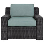 Crosley - Beaufort Arm Chair With Mist Cushion - Bring the style and comfort of indoor furniture to your outdoor spaces with the Beaufort conversation set from Crosley Furniture. This well-made, sophisticated seating collection features low-profile club styling with crisp lines and understated curves, resulting in an attractive aesthetic. Our easy-to-maintain dark brown synthetic wicker is water and UV resistant, and the solution-dyed polyester, mist-colored cushions will resist fading. Seating surfaces are generous in size, and feature resilient foam cushion inserts. With the Beaufort collection from Crosley Furniture, comfort lives outside.