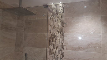Wet room with  drain, marble, alcove and feature wall.