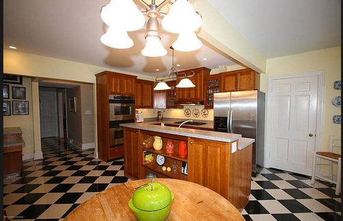 Black And White Checkerboard Tile Floor In Kitchen