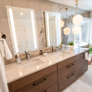 Inspiration for a contemporary bathroom in Cincinnati with medium wood cabinets, mirror tile, granite benchtops, beige benchtops, a double vanity and a built-in vanity.