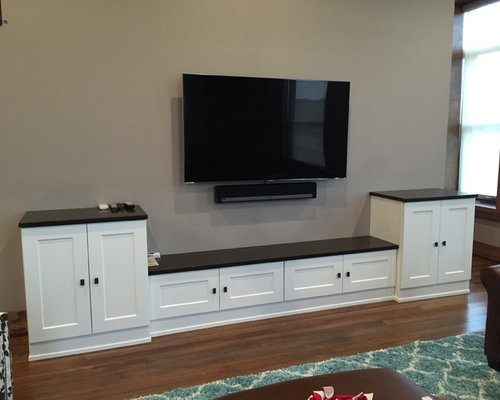 example of a small transitional open concept home theater design in other with beige walls