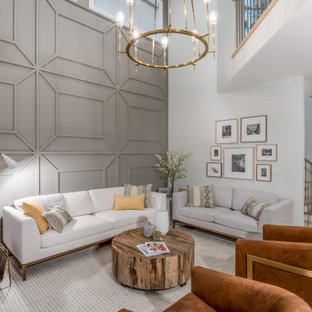バンクーバーの広いコンテンポラリースタイルのおしゃれなオープンリビング (グレーの壁、淡色無垢フローリング、ベージュの床、三角天井、パネル壁) の写真