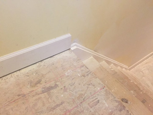 Baseboards transition down the stairs