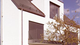 Umbau, Erweiterung und energetische Sanierung eines Mehrfamilienhauses (KfW 100)
