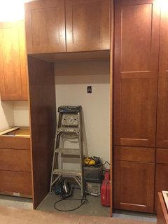 Add tall cabinet next to fridge