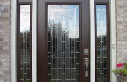 Arched Brick Doorway with Decorative Glass Door
