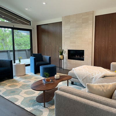 Living room - mid-sized 1950s open concept dark wood floor, brown floor and exposed beam living room idea in San Francisco with white walls, a standard fireplace, a stone fireplace and no tv