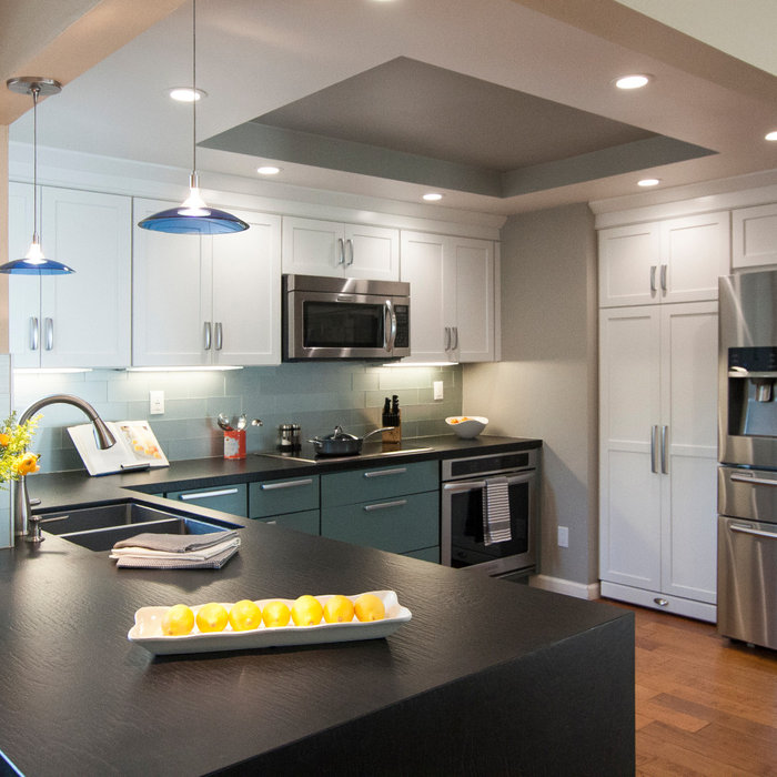 Modern kitchen with blue and white cabinets