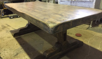This is a table we have made from reclaimed timber sourced less than a mile away