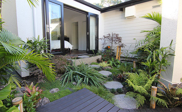 Tropical  by Zones Landscaping Specialists