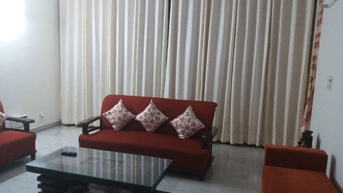 My Sofa Set Is A Shade Of Orange And The Walls Are Cream. I Have Put Cream  Curtains. Recently, An Additional Curtain Rod Has Been Installed Behind It.