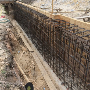 Steel cage for retaining wall of house.