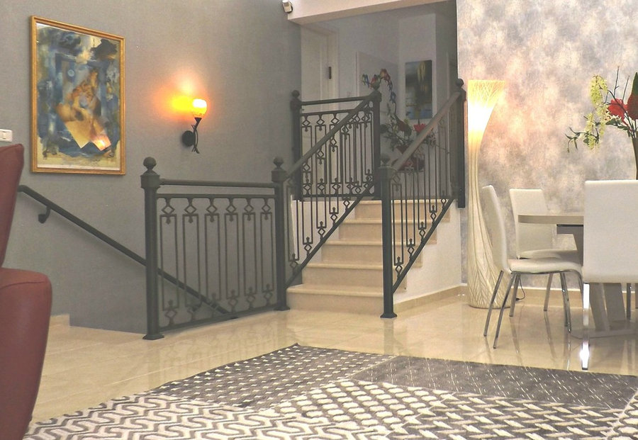 view from salon onto stairs to 2 other floors