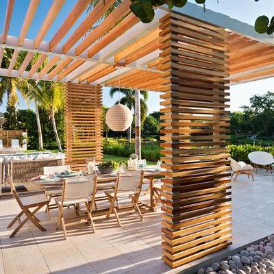 Beach style home design photo in Miami
