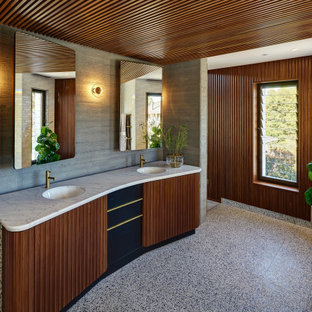 Photo of a mid-sized midcentury bathroom in Perth with marble benchtops, white benchtops, a double vanity and a built-in vanity.