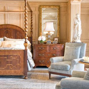 ロサンゼルスの巨大なおしゃれな主寝室 (茶色い壁、無垢フローリング、標準型暖炉、石材の暖炉まわり、茶色い床、格子天井、パネル壁)