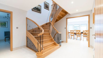 Solid oak stairs with wrought iron spindles
