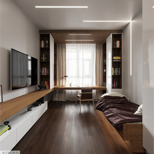 Design ideas for a medium sized contemporary teen's room for boys in Saint Petersburg with white walls, laminate floors and brown floors.