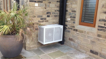 condenser unit caged, pipework in matching drainpipe