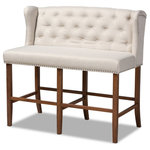 Baxton Studio - Baxton Studio Alira Beige Upholstered Walnut Finished Bar Stool Bench - Host happy hour in your home with the Alira bar stool bench. Constructed from wood, this bench provides solid seating for two. The seat and back are upholstered in a soft neutral fabric and padded with foam for endless comfort. A built-in foot rest provides additional seating comfort. Elaborate button tufting on the back gives this bench a refined look, while silver nail heads highlight the elegant wingback silhouette. The Alira is well suited for both a kitchen or bar setting. The Alira bar stool bench is made in Malaysia and requires assembly.