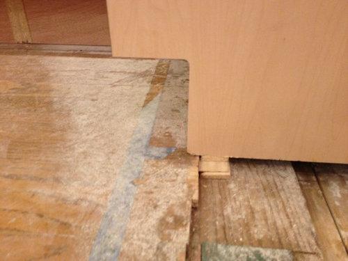 Kitchen Cabinet Installation Flooring, Install Flooring Under Kitchen Cabinets