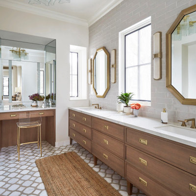 Example of a transitional master gray tile double-sink bathroom design in Chicago with brown cabinets, white countertops and a freestanding vanity