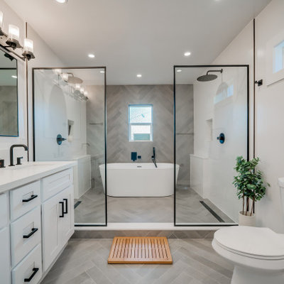 Example of a mid-sized trendy master gray tile and ceramic tile ceramic tile, gray floor and double-sink bathroom design in Los Angeles with shaker cabinets, white cabinets, a two-piece toilet, white walls, an undermount sink, quartz countertops, white countertops, a niche and a built-in vanity