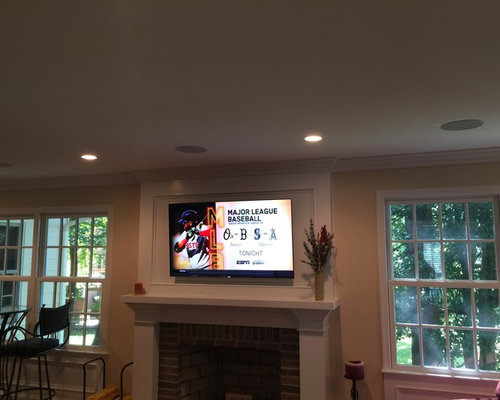 Family Room Surround Sound System With 55 Tv Over Fireplace