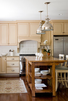 dark cabinets are better at hiding dirty finger prints hope this helps celia