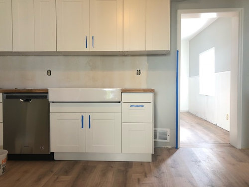 Top Cabinets Extend Past Counter Where To End Backsplash