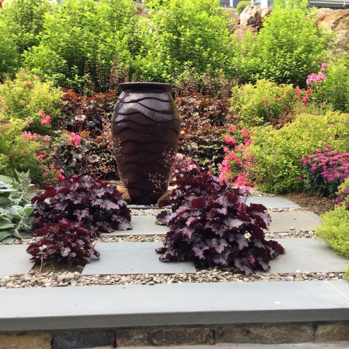 Bubbling Fountain in the Middle of Perennial Garden