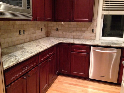 Superieur We Just Installed Typhoon Green Granite And It Looks Really Nice In Our  Traditional Kitchen With Cherry Cabinets. However. The Tumbled Beige Stone  Subway ...