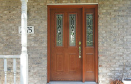 Wooden Entry Door on a Brick Exterior Home