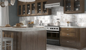 Traditional Kitchen with marble counters and tile