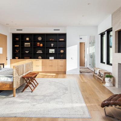 Bedroom - contemporary master bedroom idea in Orange County with white walls