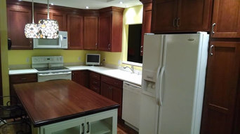 Showplace Wood Products Cabinetry Solid Surface Tops and Wood Island top.