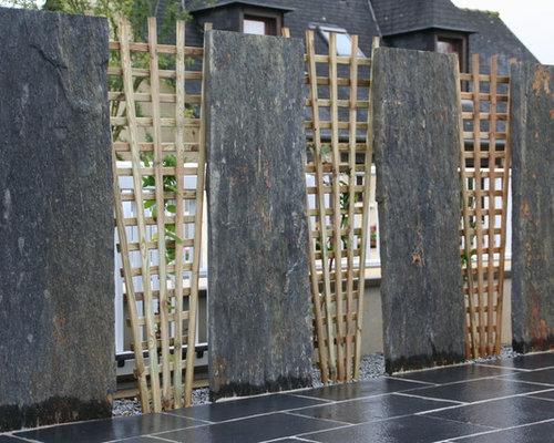 Dallage pierre naturelle et palissade ardoise et bois