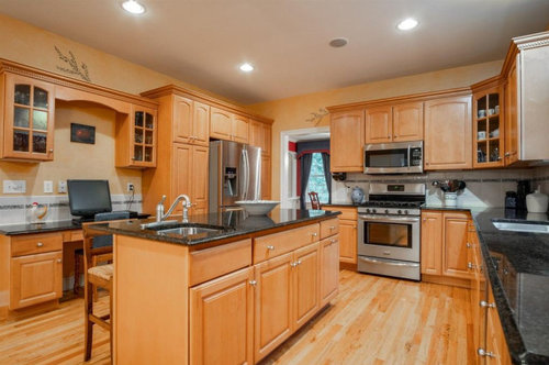Maple Cabinets And Black Granite Counters, Natural Maple Cabinets With White Granite Countertops