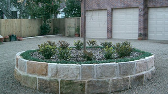 Natural sandstone garden driveway roundabout with formal plant such as mondo gra