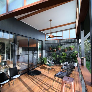 Photo of a small tropical home design in Brisbane.