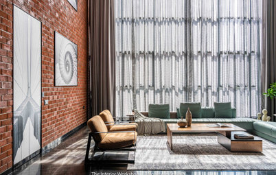 Surat Houzz: Bare Brick and Exposed Finishes Complete This Home