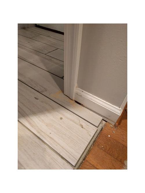 Help Tile Floor Sticks Up Higher Than Surrounding Wood Floor